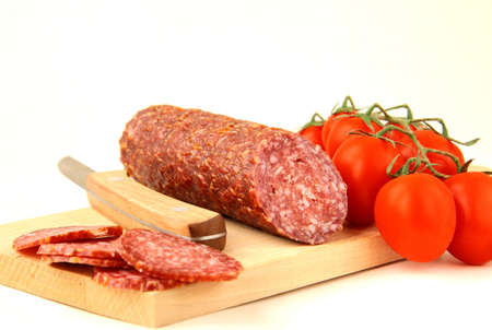 Fresh sausage, salami on white background  photo