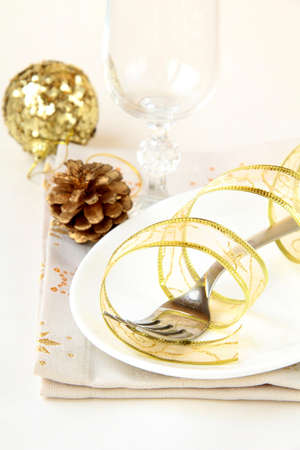 Beautiful and elegant gold place setting for christmas or celebrations  photo