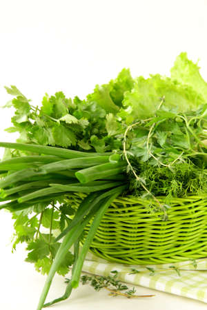 fresh green grass parsley dill onion herbs mix in a wicker basket Stock Photo - 11549768