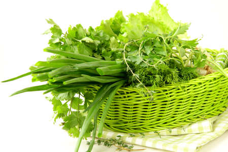 fresh green grass parsley dill onion herbs mix in a wicker basket Stock Photo - 11549770
