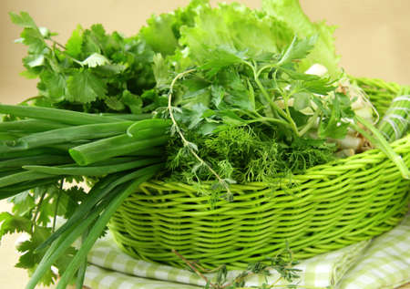 fresh green grass parsley dill onion herbs mix in a wicker basket Stock Photo - 11549784