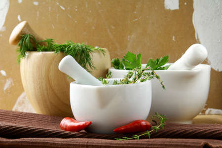 Group of mortars with various herbs photo