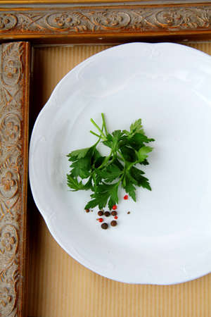 plates with  sprig of parsley - organic menu  photo