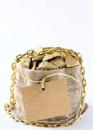 fine gold: gold nuggets on a small pouch  Stock Photo