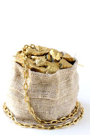 gold nuggets on a small pouch  photo