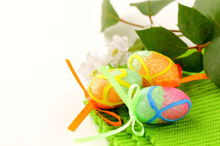 The Easter composition eggs,  green grass over white Stock Photo - 11958600