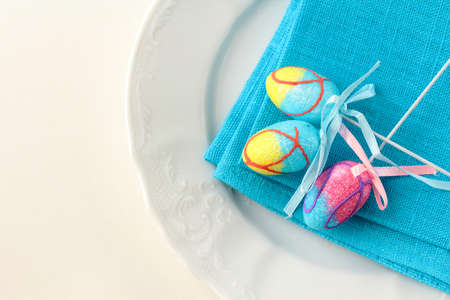 Place setting for Easter elegant and blue photo
