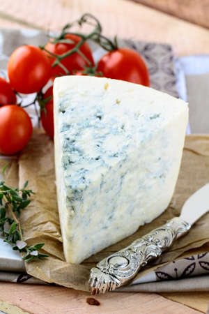 piece of blue cheese, tomato  and cheese knife Stock Photo - 11958612