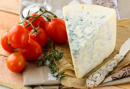 piece of blue cheese, tomato  and cheese knife  photo