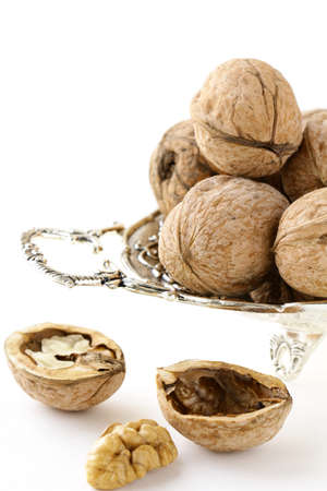 whole and chopped walnuts on the white background  photo