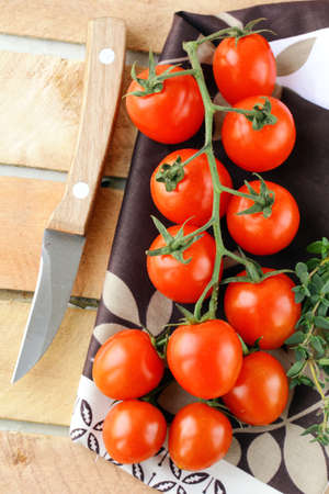Tomatoes Cherry fresh ripe  on a  wooden board  photo