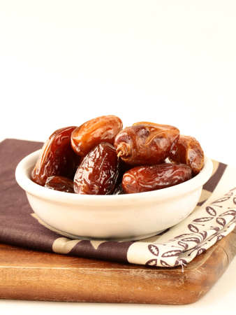 Plenty of ripped dates in white cup photo