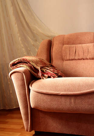settee: interior of the sofa with a blanket