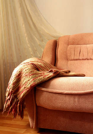 draped: interior of the sofa with a blanket