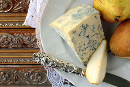 Blue cheese and pears on a vintage background Stock Photo - 12479379