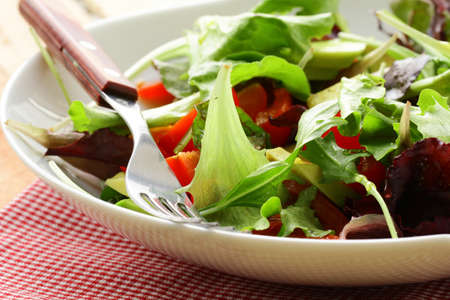 mix salad (arugula, iceberg, red beet) in a bowl on the table photo