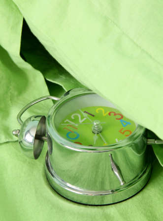 green alarm clock under your pillow photo