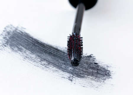 smudged: brush with black mascara  for makeup Stock Photo