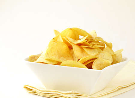 potato chips in a white bowl  Stock Photo - 12522770