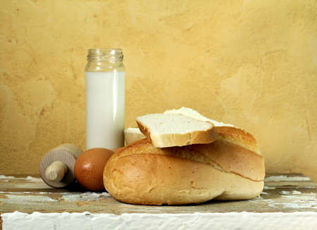 still life - bread, milk, flour, eggs photo