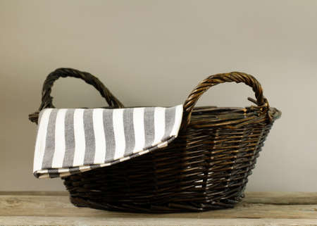 gift basket: an empty wicker basket on a gray background Stock Photo