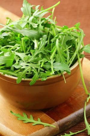 bowl of fresh green, natural arugula Stock Photo