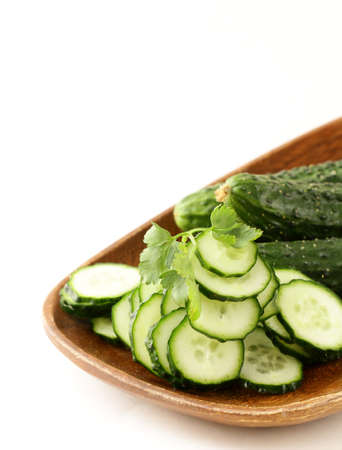 cut into slices of cucumber on white background photo