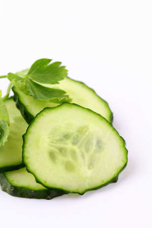 cut into slices of cucumber on white background Stock Photo - 12832371