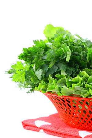 fresh green grass parsley dill onion herbs mix in a wicker basket photo