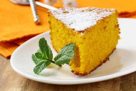 powdered sugar: Carrot cake with powdered sugar and mint Stock Photo