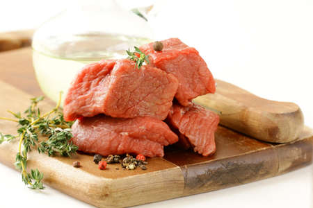 Fresh raw beef with thyme and spices on a cutting board Stock Photo - 13138099