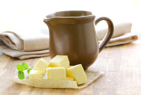 fresh yellow butter on a wooden table Stock Photo - 13268372