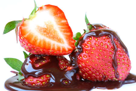 ripe and fresh strawberries with chocolate sauce on a white background photo