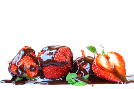 ripe and fresh strawberries with chocolate sauce on a white background Stock Photo - 13586288