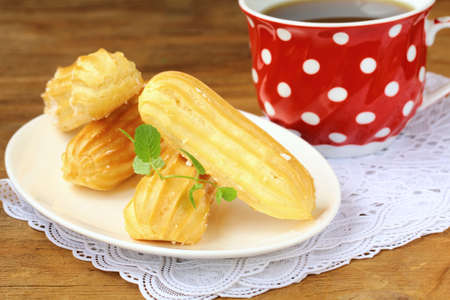 creampuff: cake eclair profiteroles on a plate