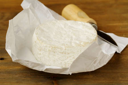 Cheese camembert on a wooden table and a special knife Stock Photo - 13880612