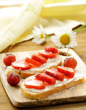dessert sandwiches with strawberry  and soft cheese photo