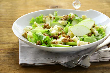 salad with apples, walnuts and cheese photo