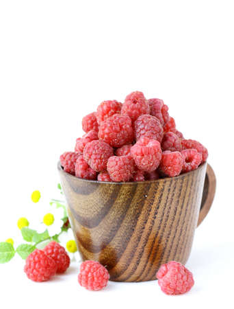 juicy ripe raspberries with mint leaves photo