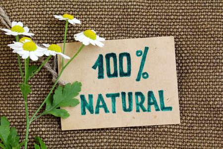 environmentalist label: Organic label on the natural  burlap background