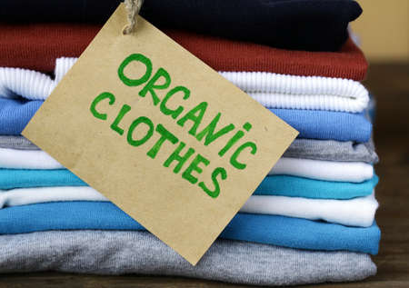 stack of colorful clothing with organic label  photo