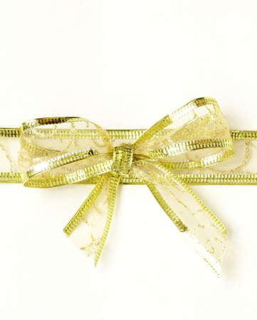golden ribbon tied bow for holiday background photo