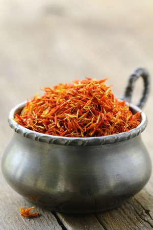 intense flavor: saffron treads in pile,  wooden board