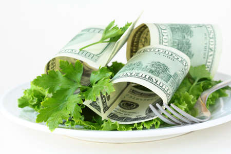 U.S. currency dollars on a plate -  salad cash  Stock Photo