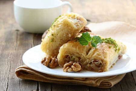 turkish ethnicity: traditional Turkish arabic dessert - baklava with honey and nuts