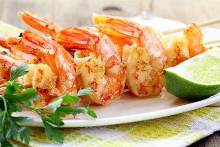 calamari: ready to eat grilled shrimp with lime and parsley Stock Photo