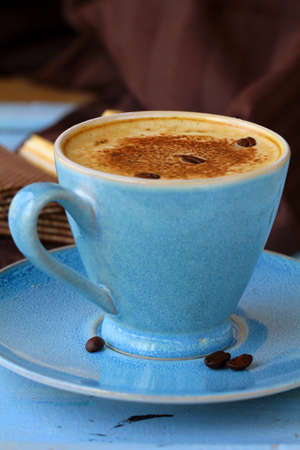 coffee cappuccino in a  blue ceramic cup photo