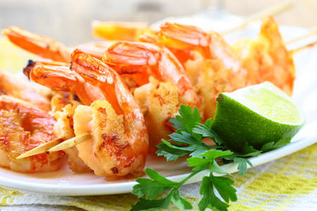 ready to eat grilled shrimp with lime and parsley photo