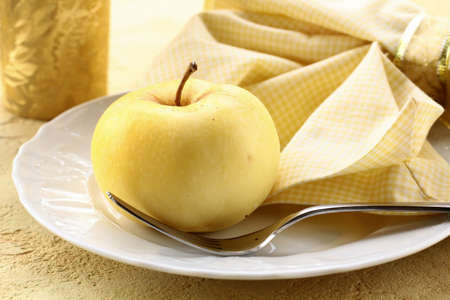 Autumn table setting in yellow with apple photo