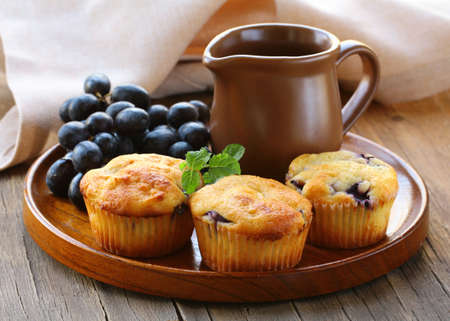 backing: homemade fruit cupcakes on the wooden plate